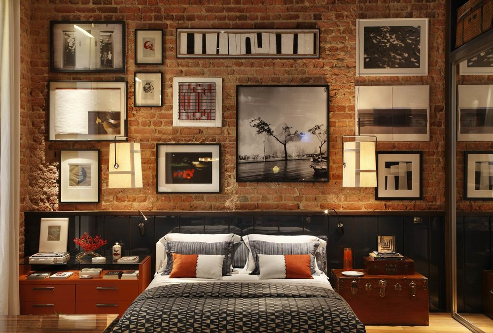attractive-exposed-brick-wall-design-of-master-bedroom-with-nice-wall-picture-frame-over-twin-size-beds-and-bnrown-varnished-wooden-nightstand-as-well-as-streamer-trunk-storage-bedside-table.jpg
