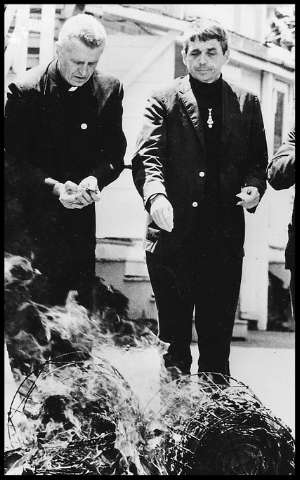 Jesuit priest Father Berrigan, right and his brother Philip Berrigan seized hundreds of draft records and set them on fire in 1968.