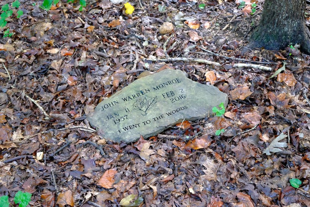 "The woods are a lush place, a cool damp resting spot where a more recent burial than Clark's bears the inscription, ""I went to the woods."""