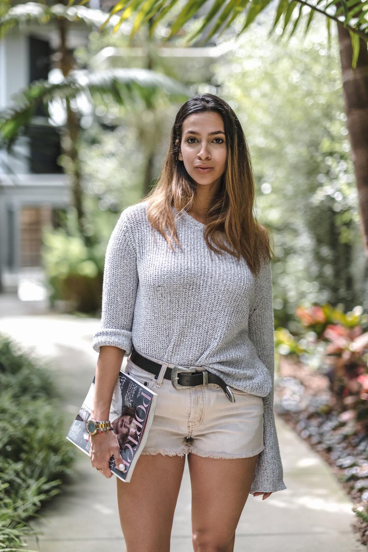 sweater - Brandy Melville | belt - Urban Outfitters | jeans - Free People | booties - Zara | magazine - Porter Magazine | Styling: Dana Clerici | Photos by: Jason Kirsch