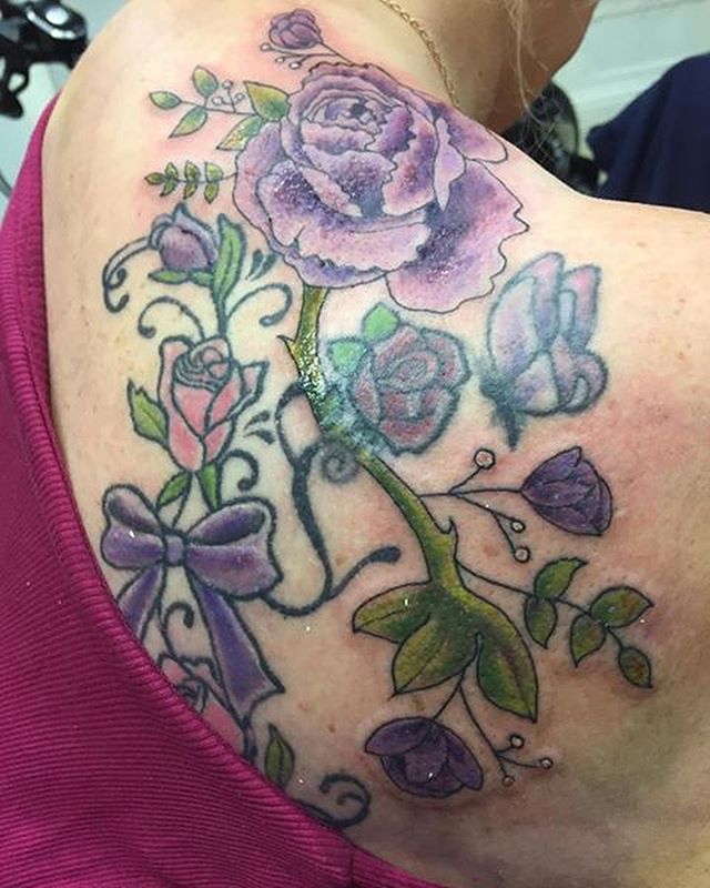 Swipe ⬅️ Lisa previously has this tattoo done elsewhere, and wanted to add on some other floral pieces.  Owner & Artist @nikcarville reworked the previous flowers and added on more flowers, look at how amazing this looks!! #coveruptattooartist #coveruptattoo #colourtattoos #tattoosofinstagram #backtattoos #floraltattoos #flowertattoos #tattoosoftheday #tattoosofinsta #nikcarville #carvilles #carvillestattooist #carvillestattoostudio #girlytattoo #girlstattooed