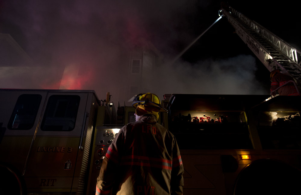 Firefighters from numerous cities and towns fight a fire on Pierce and Bartlett Streets in Lewiston, Maine on May 3, 2013. The fire rapidly engulfed four apartment buildings, and is the second multi-building fire in five days in downtown Lewiston.