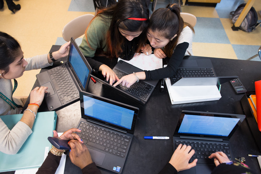 Rupa Thapa, top left, and Suk Rai, top right, work on Chromebooks during a science class at Rochester International Academy in Rochester, New York on Tuesday, February 23, 2016. The district is in the early stages of a planned 1:1 device to student program.