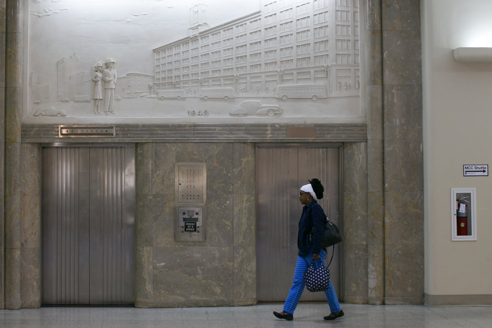 Monroe Community College students wait for an elevator at Sibley Square in Rochester, New York on Wednesday, October 5, 2016. The former home of Sibley's department store, the 1-million square foot building is undergoing a major renovation to add apartments, retail, and commercial space.
