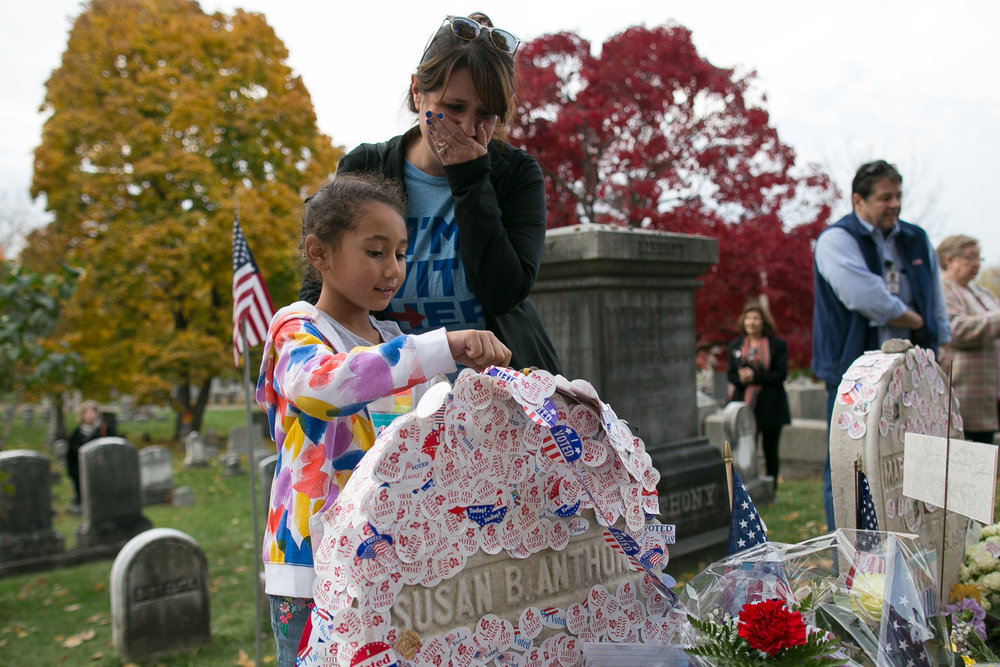 "Betsy Wilson tears up as her daughter Gabby Wilson places an ""I Voted Today"" sticker on the gravesite of Susan B. Anthony, the social reformer who played a key part in the movement for women's suffrage, at Mount Hope Cemetery in Rochester on Election Day, November 8, 2016."