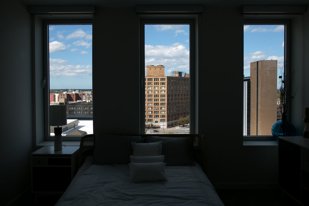 An apartment at Tower280 in Rochester, New York overlooks Sibley Square, center, a long-empty building that is currently being completely renovated to add residential, retail, and commercial space.