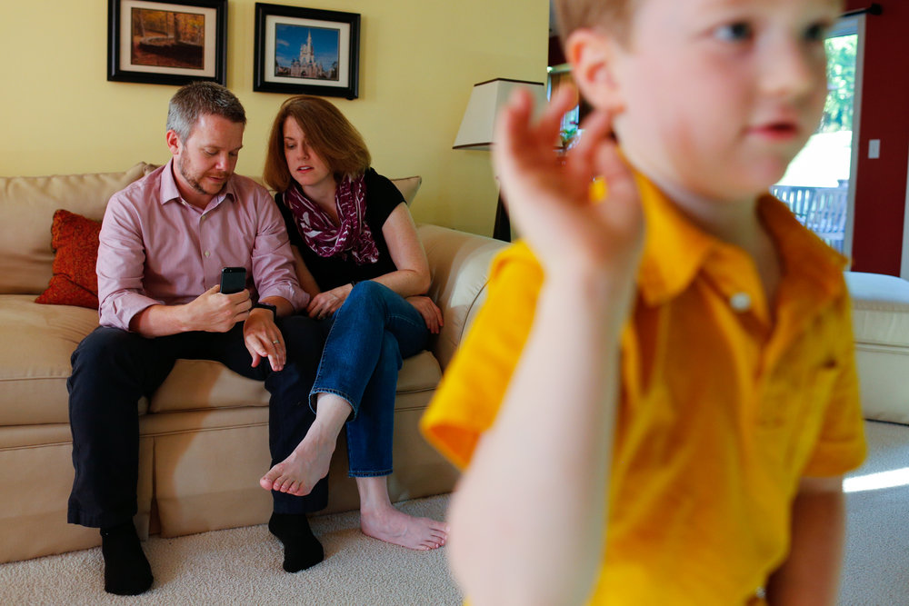Evan Costik plays a game on Xbox Kinect while his parents John and Laura monitor his blood sugar on John's smartphone at their home in Livonia, N.Y. on August 27, 2014.  Evan, 6, has type 1 diabetes John modified a continuous glucose monitor and an Android smartphone to provide constant updates on Evan's blood sugar remotely.