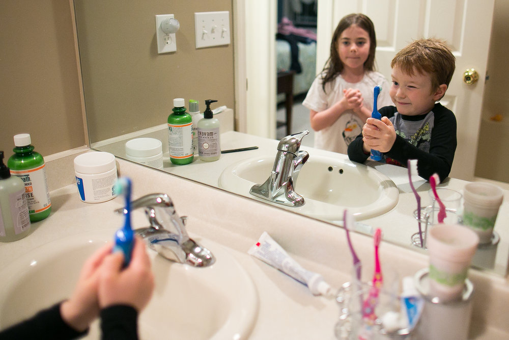 Evan and Sarah brush their teeth before bed.
