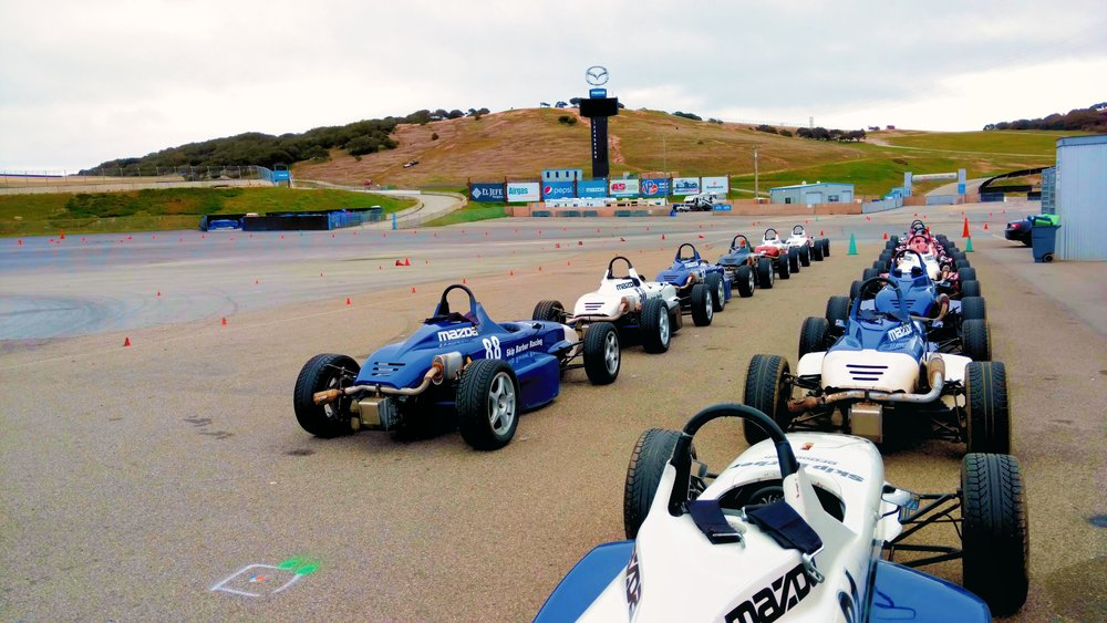 Skip Barber Formula cars lined up in the paddock