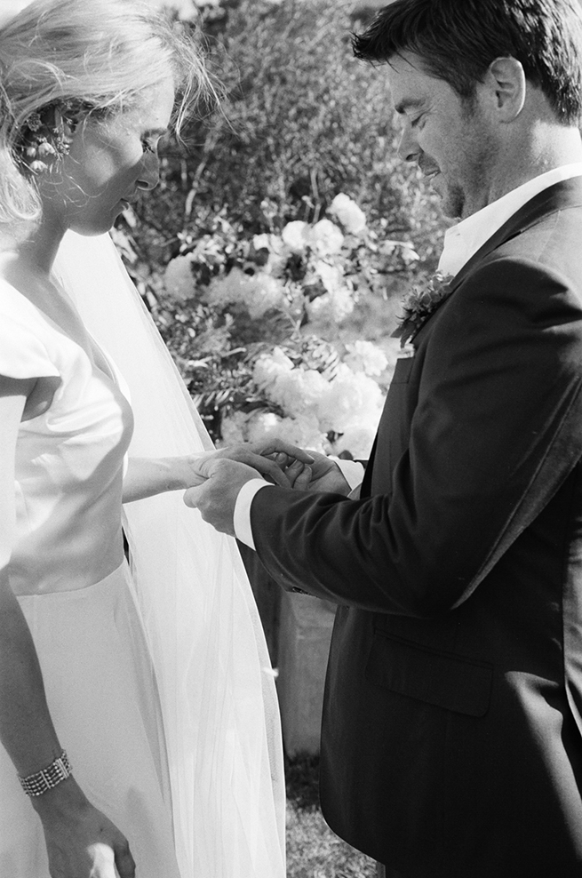 09-bride-groom-ring-exchange-ceremony-black-white.jpg