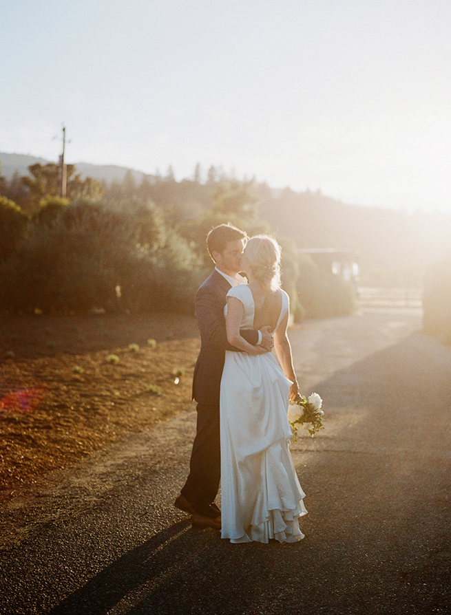 32-bride-groom-kiss-johanna-johnson-dress-sunlight-california-sun.jpg