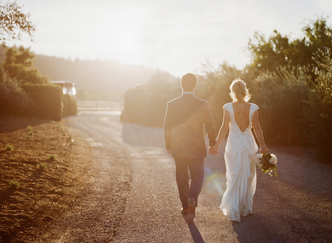 33-bride-groom-walk-into-sun-johanna-johnson-dress-sunlight-california-sun.jpg
