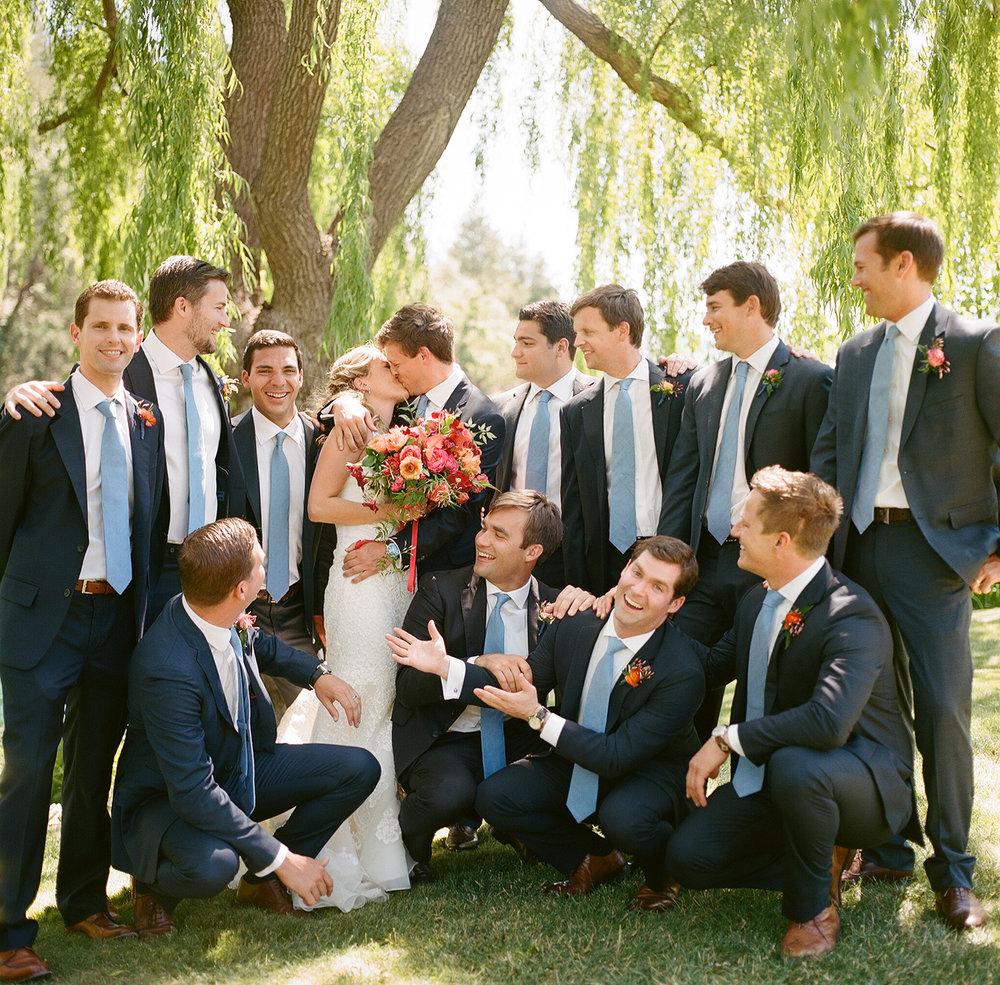 11-bride-groom-kiss-groomsmen.jpg