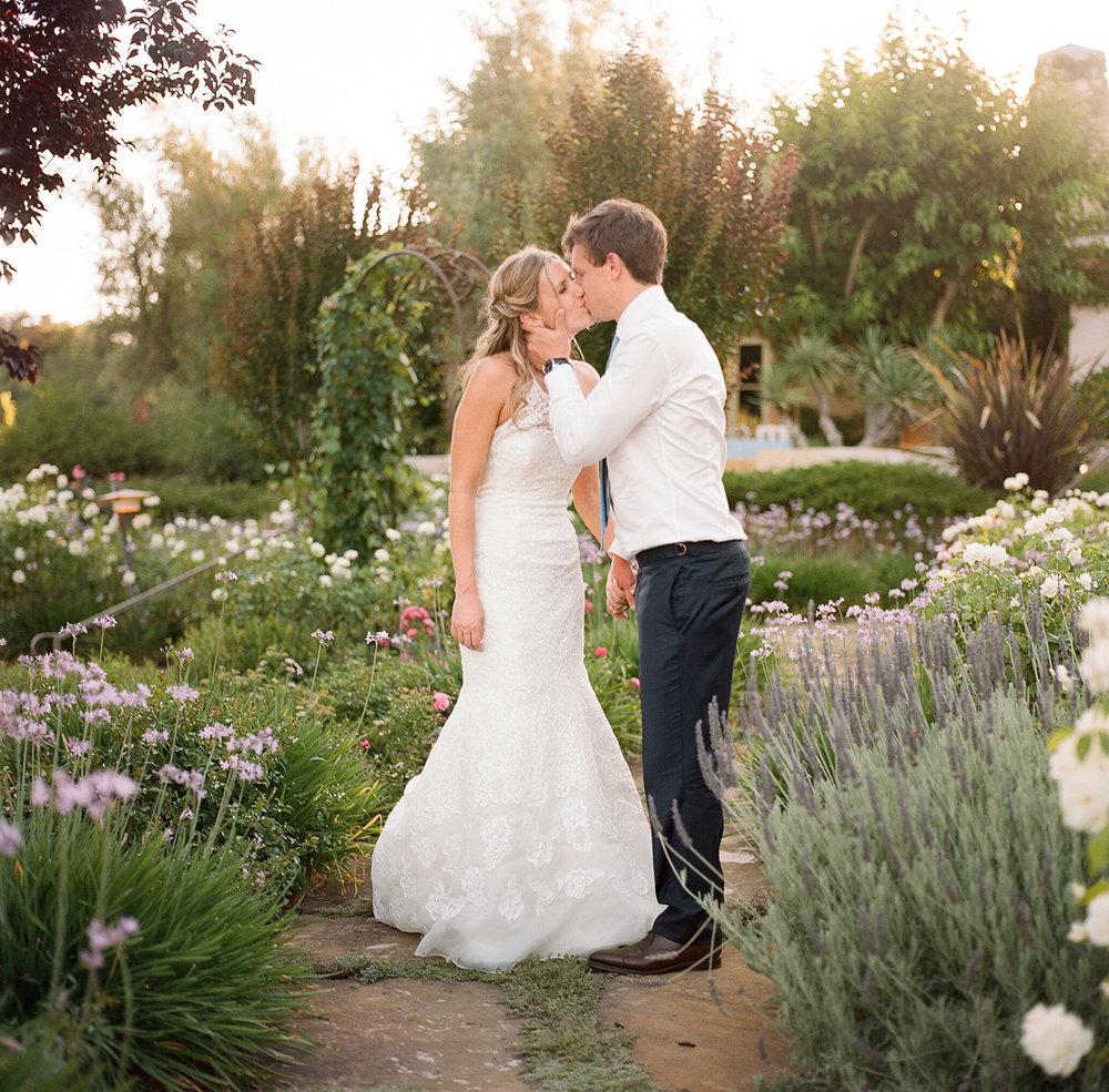 36-bride-groom-kiss-garden.jpg