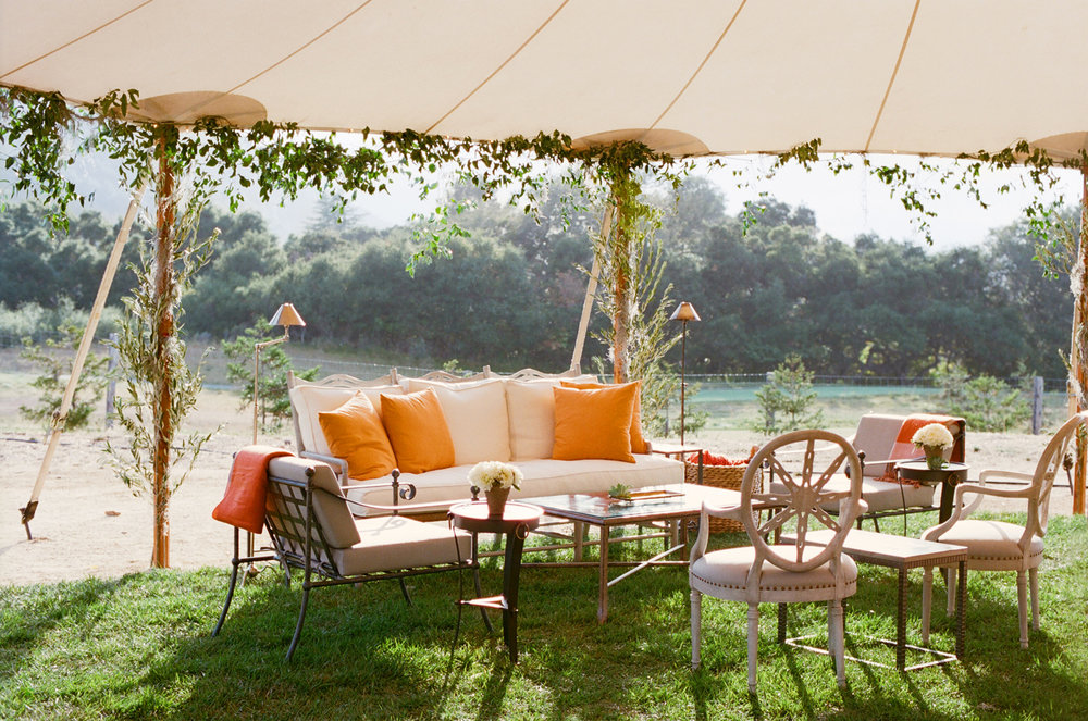 20-tented-wedding-sod-orange-pillows.jpg