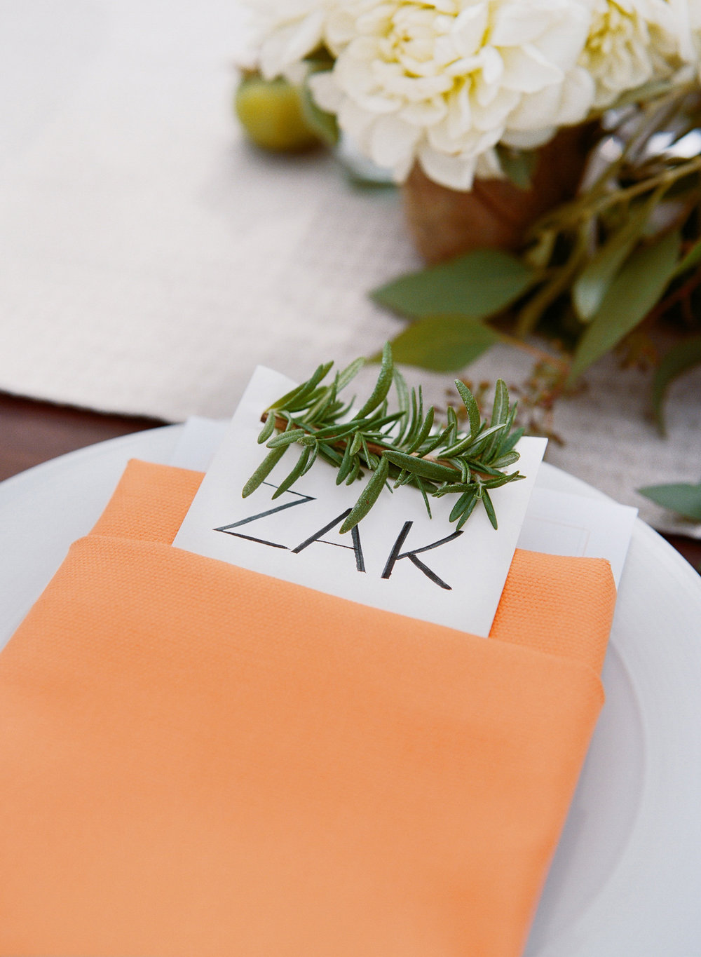 33-masculine-tablescape-orange-napkin.jpg