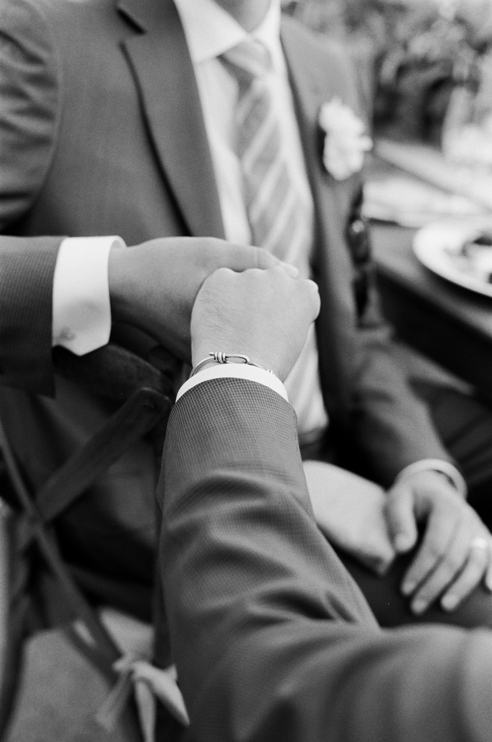41-groom-holding-hands.jpg