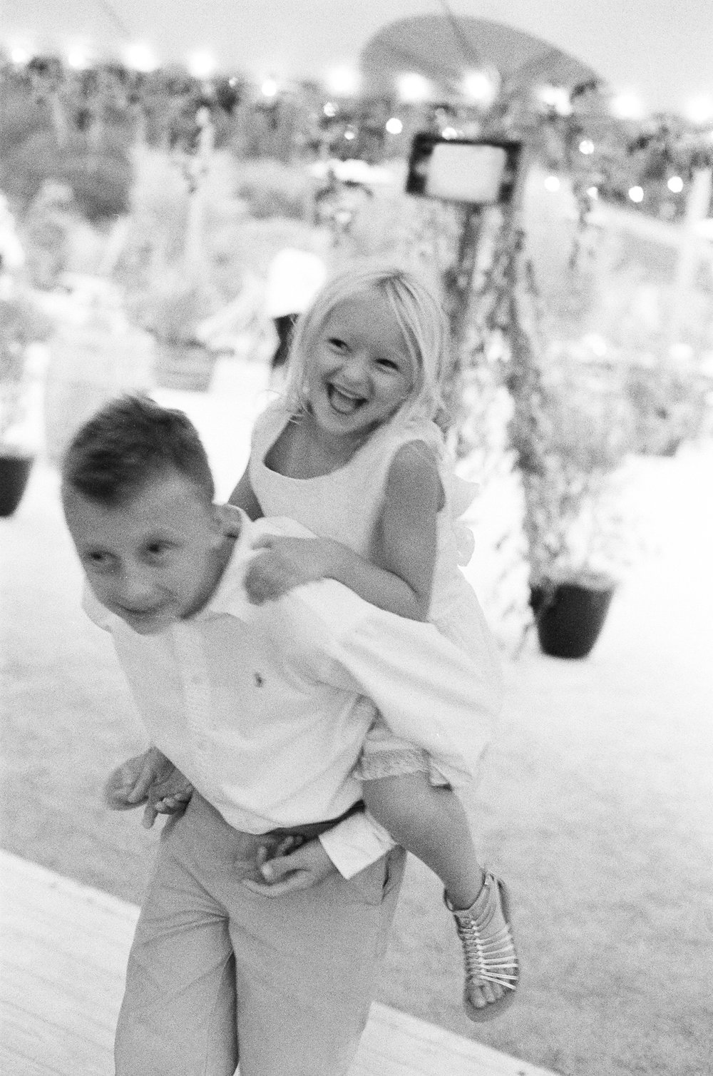 43-piggy-back-ride-wedding.jpg