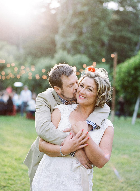 47-groom-kisses-bride.jpg