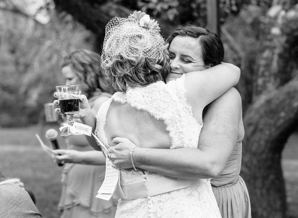 49-bridesmaid-hugs-bride.jpg