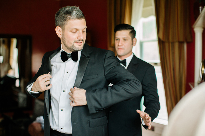 12-groom-putting-coat.jpg