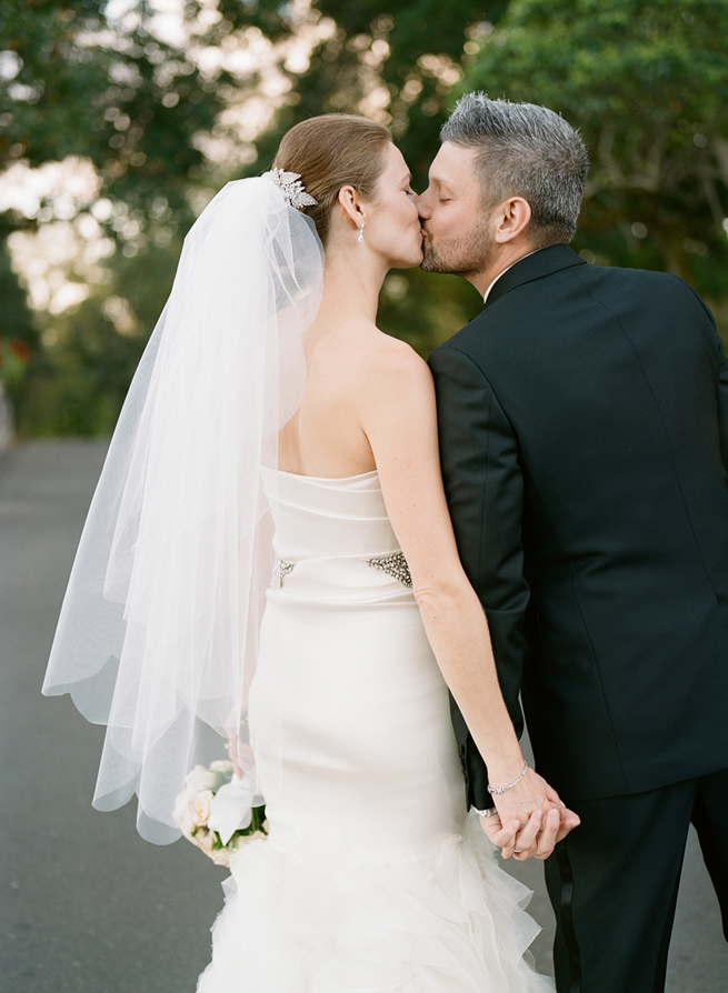 37-bride-groom-kiss-fingertip-veil.jpg