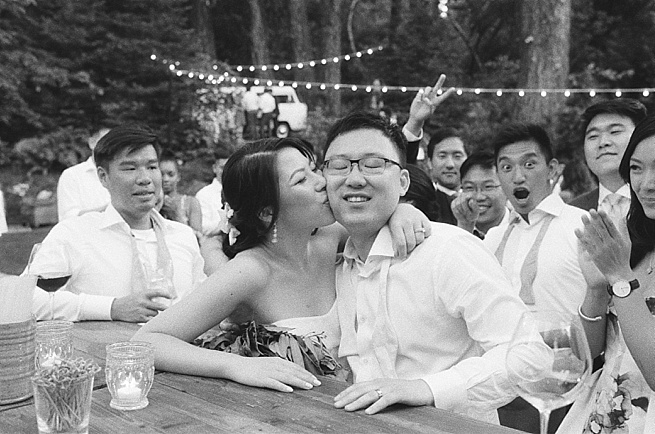 56-bride-kisses-groom-cheek.jpg