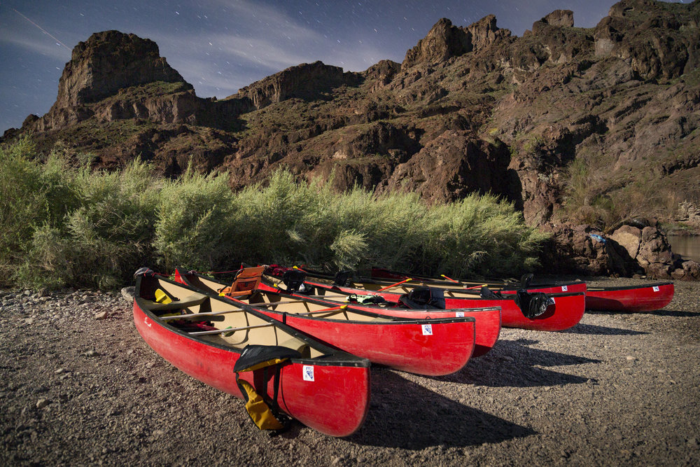 Canoes lit by the full moon at Arizona Hot Springs