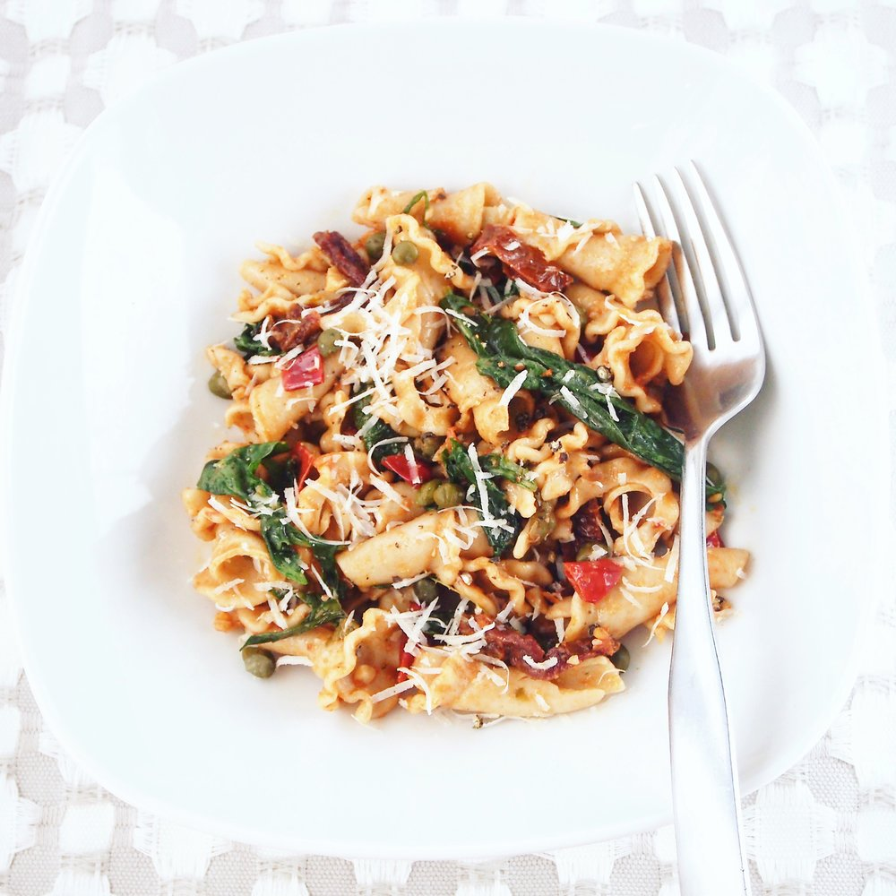 This sun-dried tomato pasta with arugula is quick and easy to make. It's similar to puttanesca, but healthier with whole-wheat pasta and arugula.