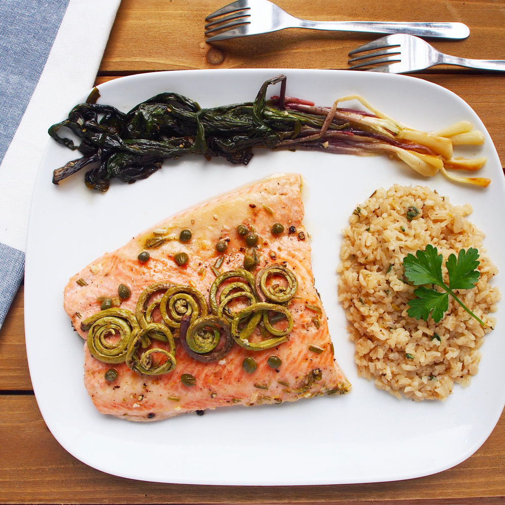 This broiled steelhead trout recipe is broiled with wild fiddleheads and ramps, a.k.a. wild leeks.