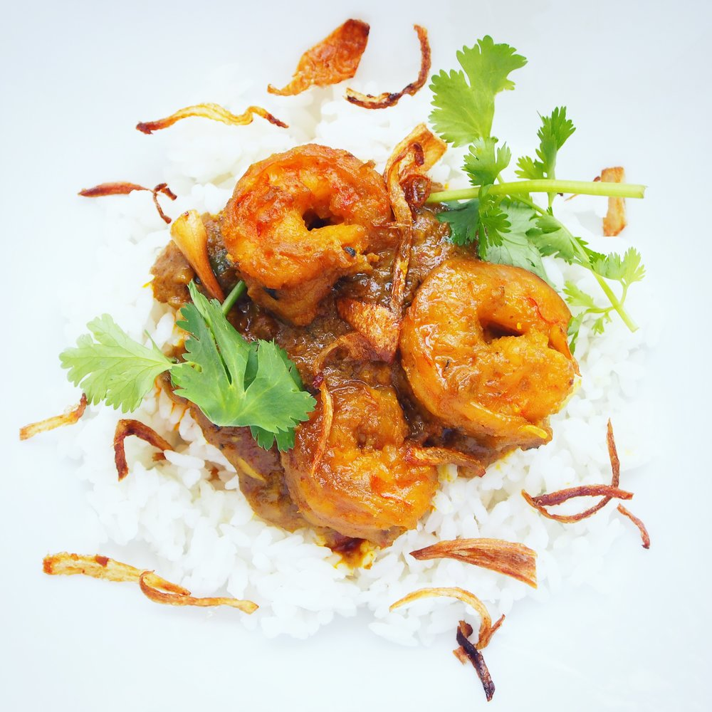 This delicious Indonesian-Style Shrimp Curry Recipe is so delicious, you will have no room for leftovers! This shrimp curry uses a lot of Indonesian ingredients, including candlenuts, shrimp paste, and sambal!