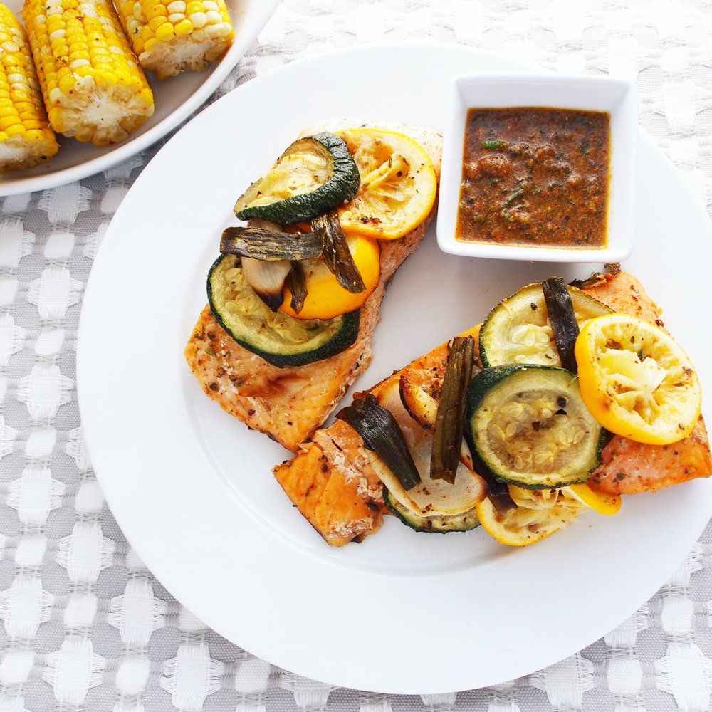 An easy roasted salmon recipe with roasted vegetables! This salmon is the best recipe to pair with summer vegetables from your garden, such as zucchini, corn, spring onions, and lemons!