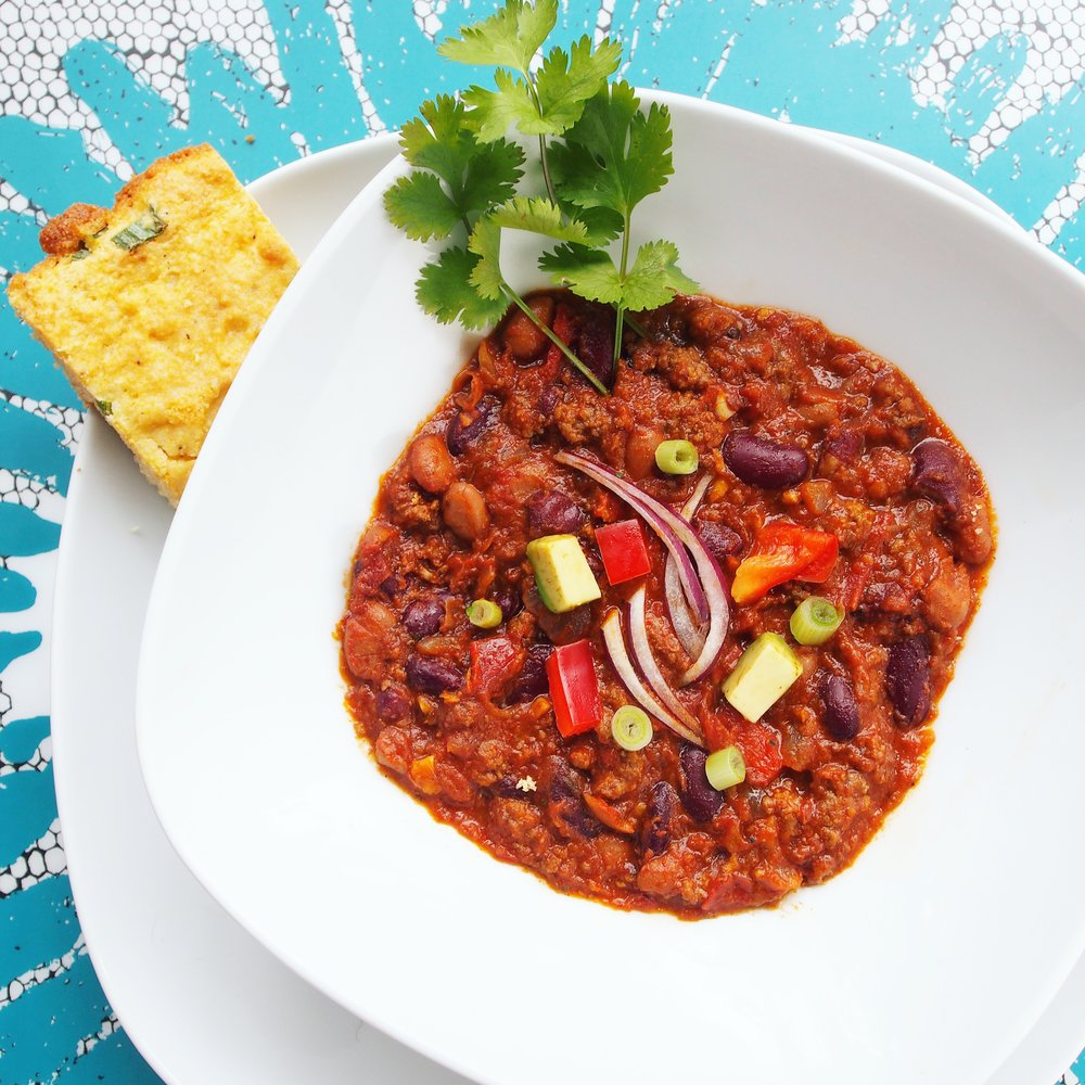 This Hearty Beef Chili with Cornbread is the best homemade chili recipe I've tried. It's a little spicy with chipotle peppers and totally hits the spot! Absolutely a yummy part of Ayesha Curry's Homemade Meal Kits.