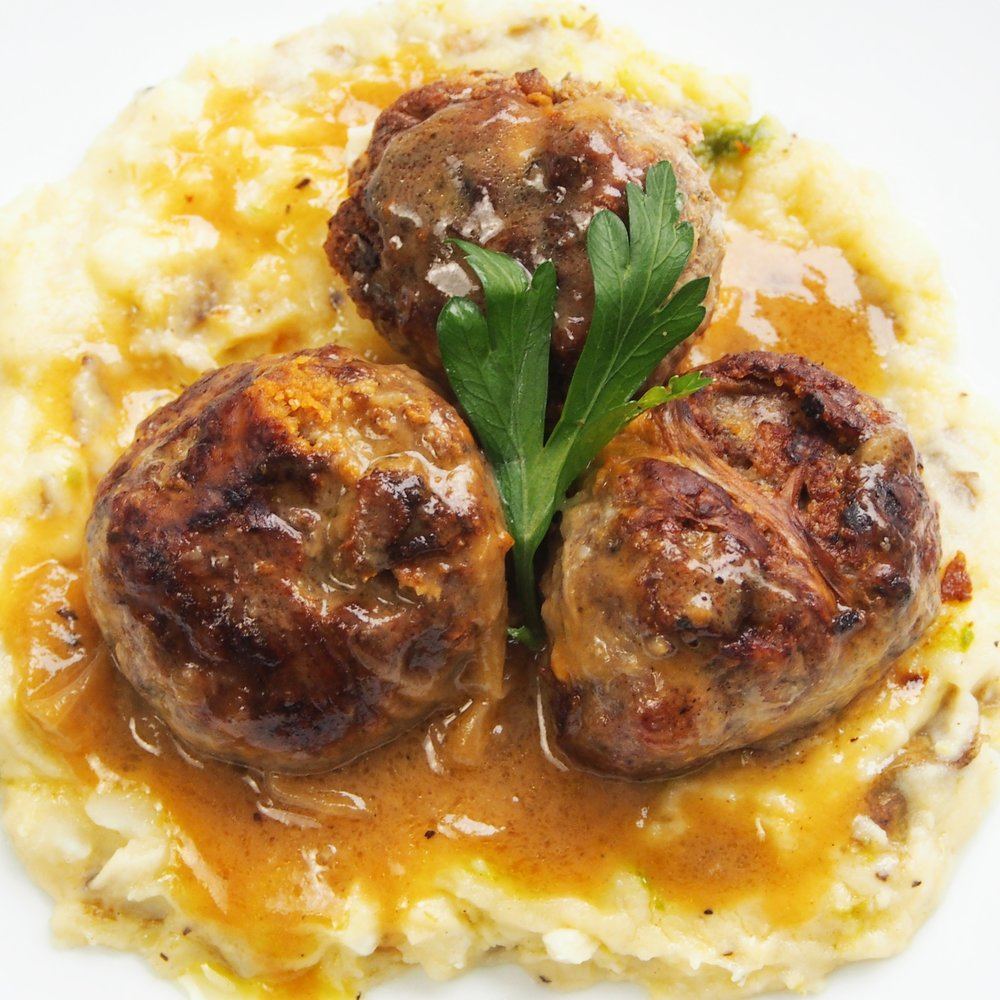 Welsh Meatballs are known as ffagadau in Wales, but more commonly known as Welsh Faggots. They're basically the best meatball recipe you can make because they have bacon, ground pork, and are wrapped in suet.