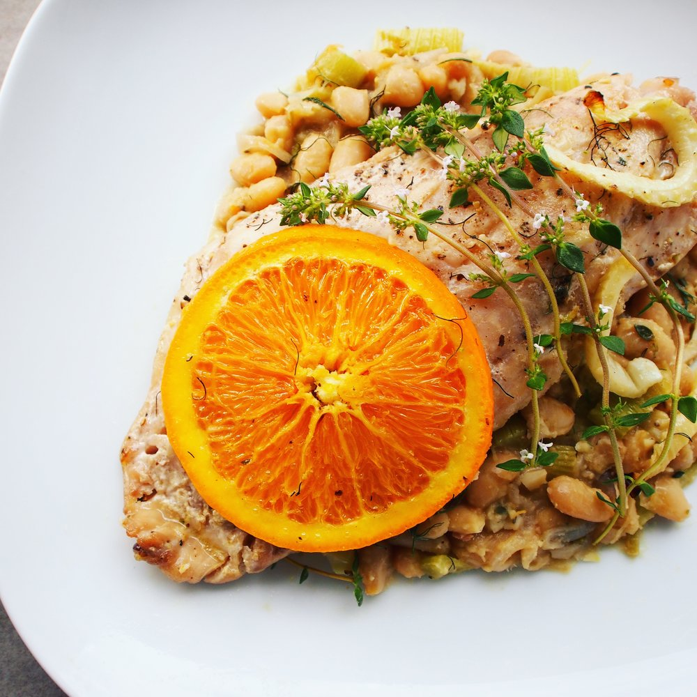 Broiled rockfish with oranges, fennel and cannellini beans come together to create the perfect light summer dinner