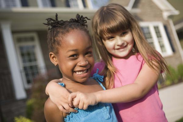Euroamerican-Girl-Hugging-African-American-Girl.jpg