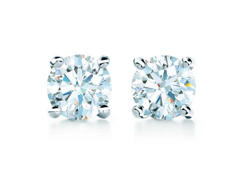 - TIFFANY SOLITAIRE DIAMOND EARRINGS, $1,200