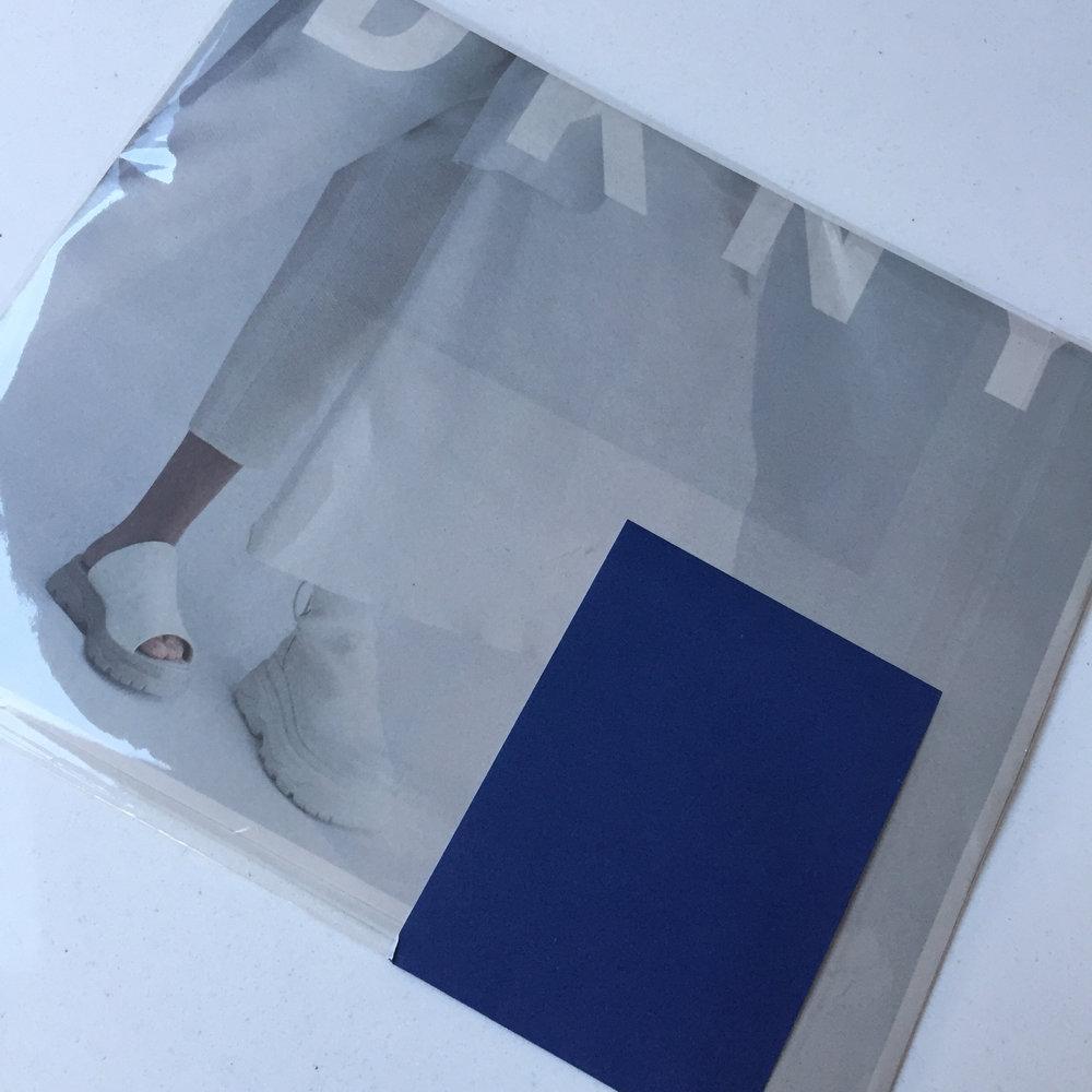 unopened mailer back, showing cobalt blue sticker. Courtesy DKNY