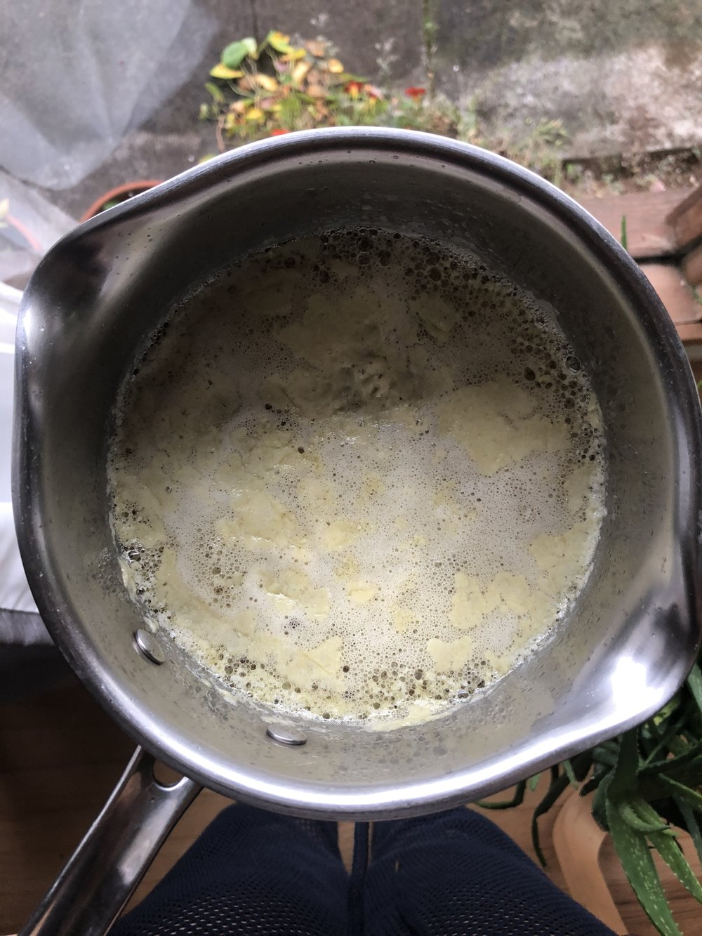 Step 4 - This is what the milk solids will look like when the ghee is done. Remove from heat. To make the straining easier, you may choose to spoon the milk solids off the top and discard.