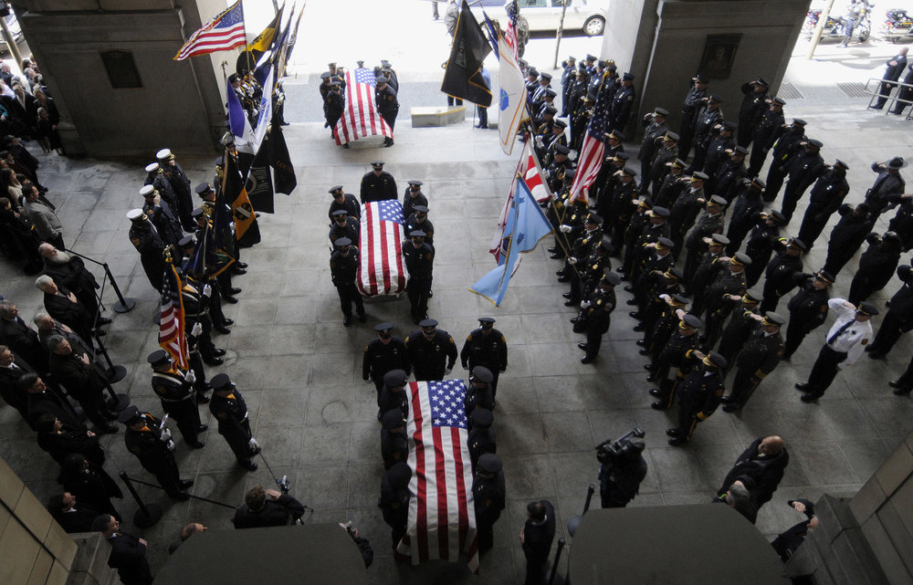 Caskets of three slain Pittsburgh Police officers at the City-County Building.