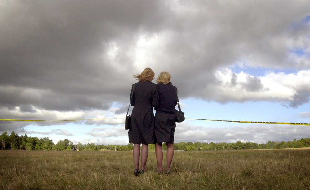 Airline attendants grief loss of friends near 9/11 crash site in Shanksville, PA.