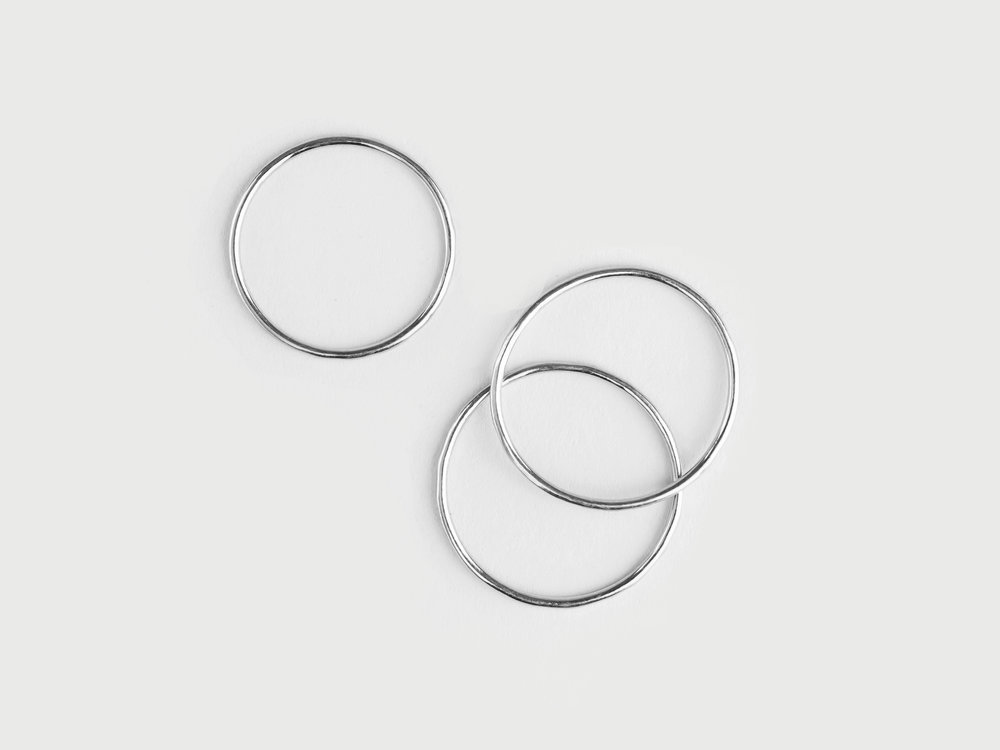 Simple thin stackable band rings in sterling silver with polished finish by the savvy heart