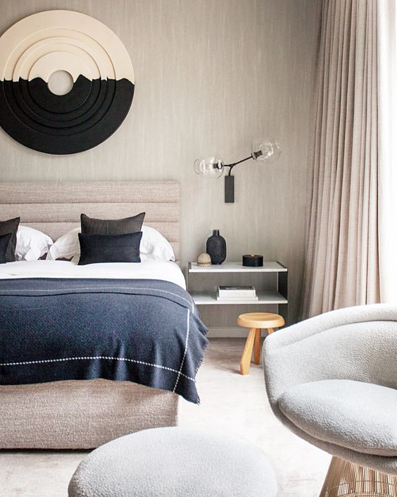 A bedroom full of layers and textures in all the textiles. Image  via