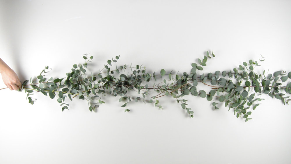 create a focal point on the table with some eucalyptus branches