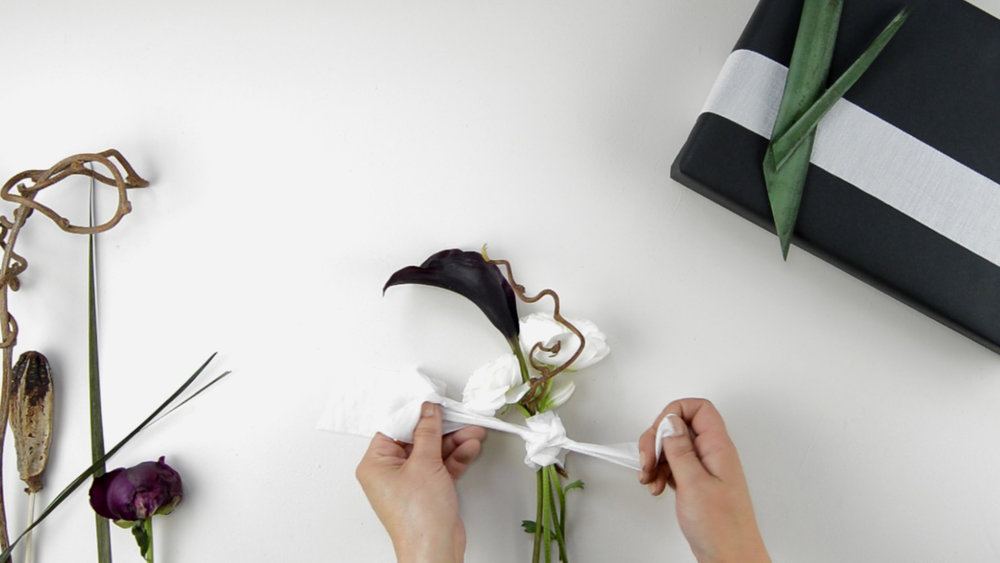 Step 5 - Wrap ribbon around the bouquet, hiding the string, and knot it