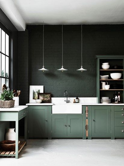 Hunter Green Painted Kitchen Cabinets and Brick Wall - A green color palette by the savvy heart