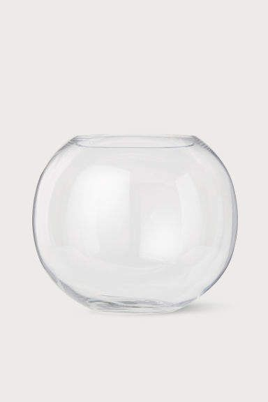 Large clear round glass vase for flowers or branches for a living room coffee table