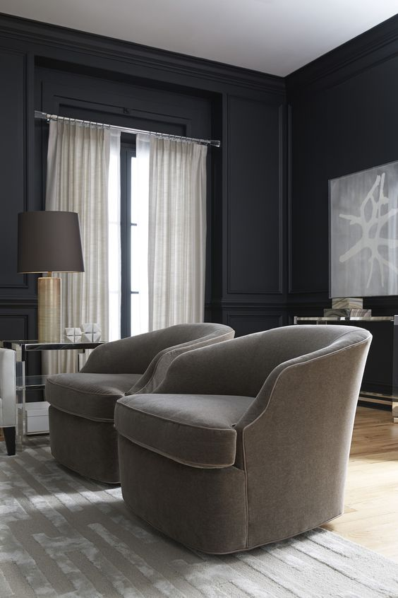 Moody and Dark Living Room with Two upholstered swivel accent chairs