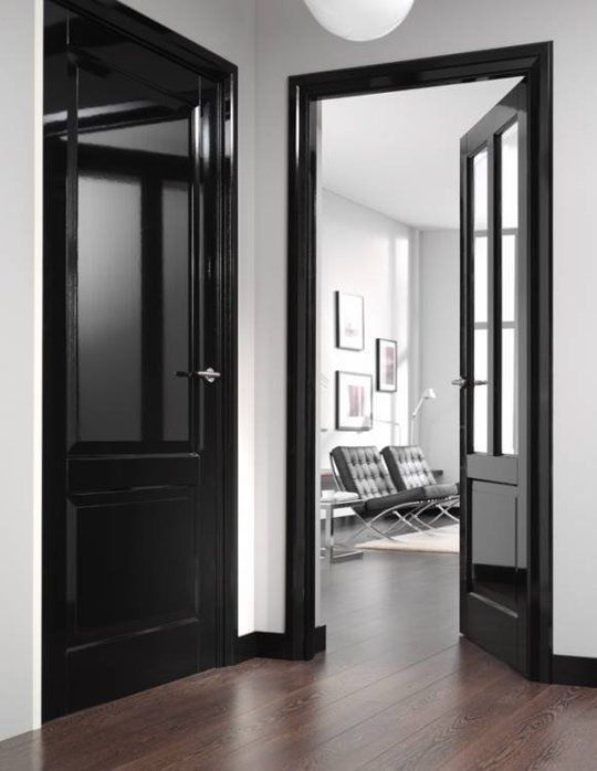 Black High gloss finish on Interior Doors and Trim in a hallway home