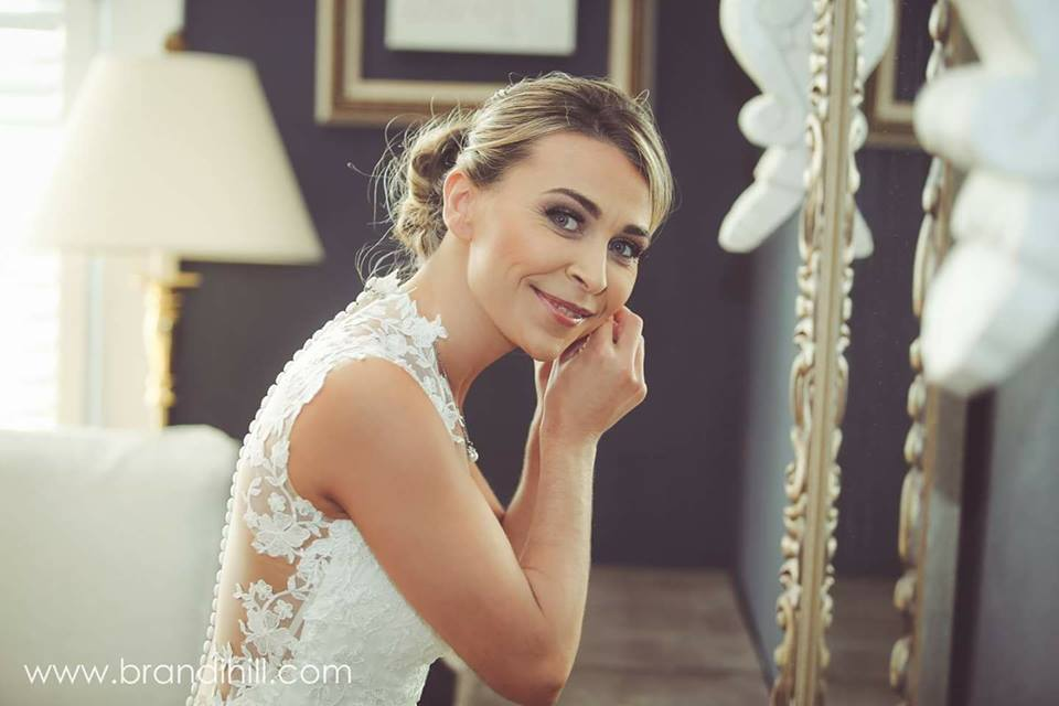 beautiful bride getting ready at the grand magnolia house.jpg
